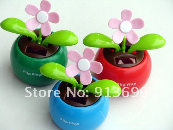 3PCS/LOT,Free Shipping Solar Apple Blossom Shaking his head the Sunflowers Doll Grass doll Automotive Supplies Car Decorations(China (Mainland))