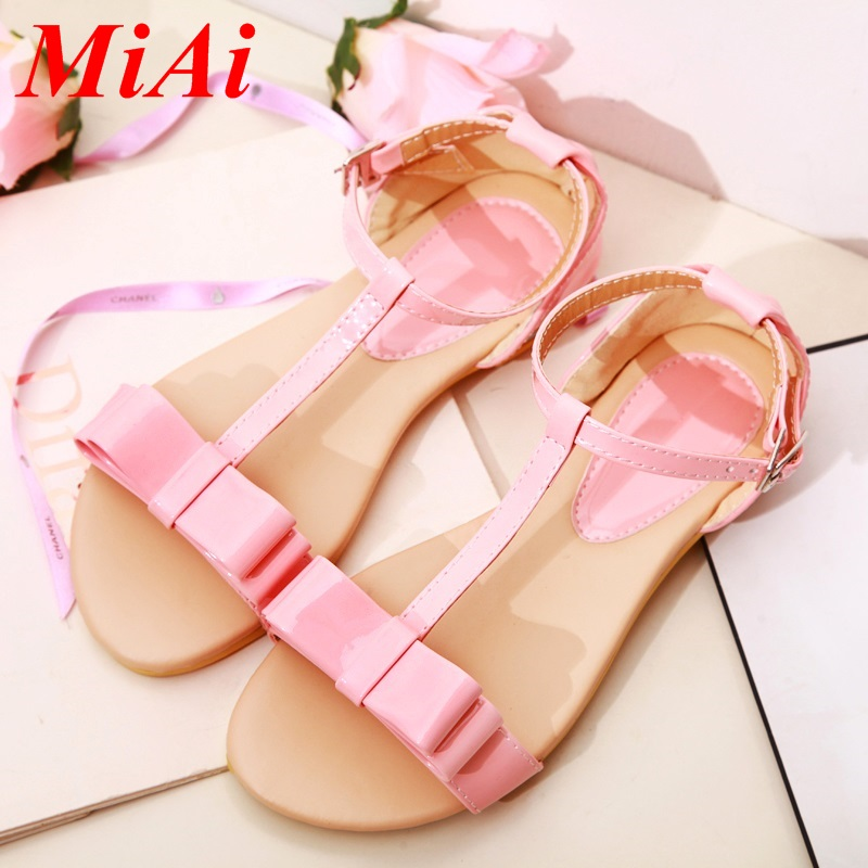 new 2016 sexy gladiator ankle straps flat heels fashion brand buckle women sandal summer T-tied open toe sandalias size 34-39<br><br>Aliexpress