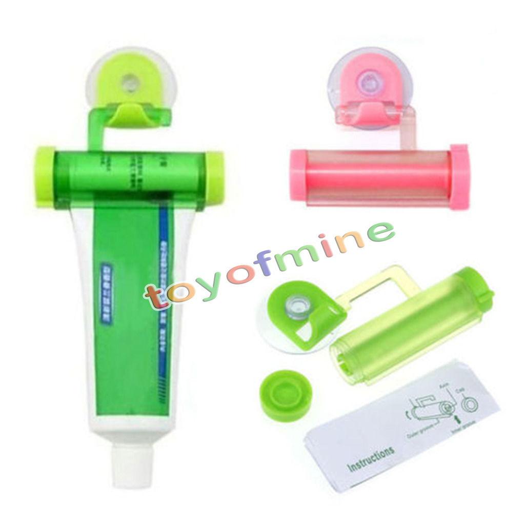 1PCS Cute Rolling Squeezer Toothpaste Dispenser Tube Partner Sucker Hanging Holder(China (Mainland))