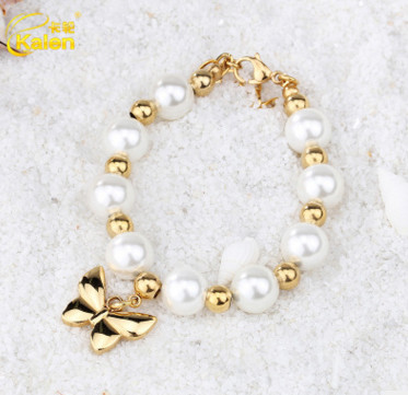 Beautiful jewelry cheap shell pearl bracelets with 18k gold butterfly charm designs for sweet girls from China jewelry supplier(China (Mainland))