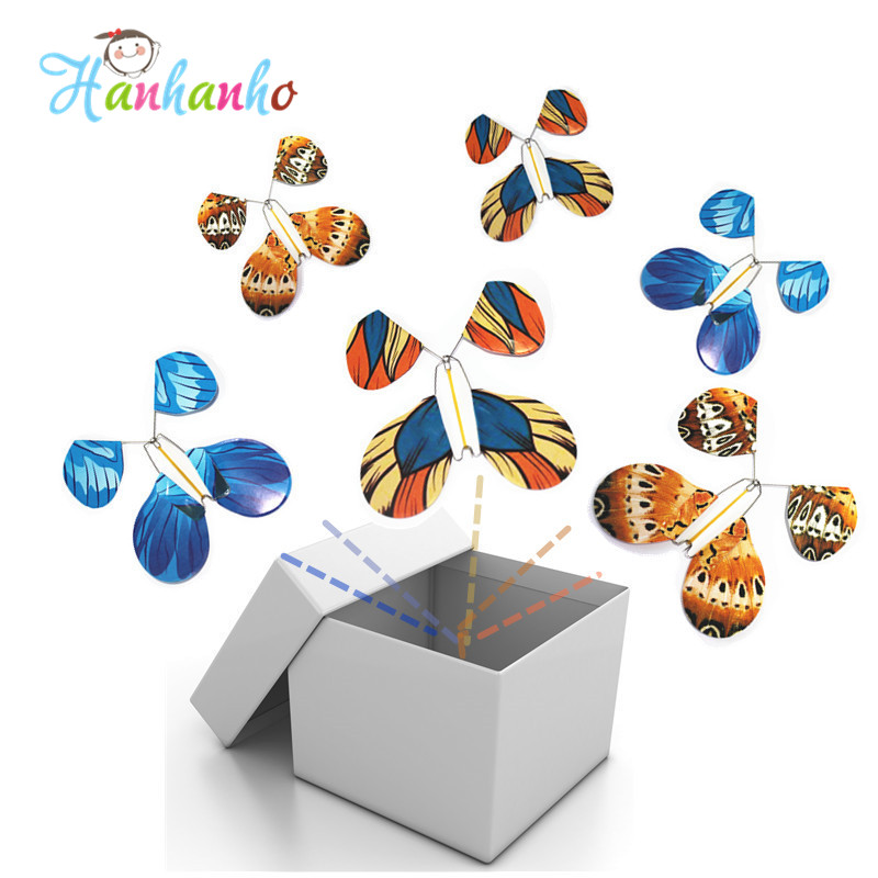 1pcs Magic Flying Butterfly Iron Wire Frame Wind UP Paper Butterflies Magic Tricks Toys Wedding Surprising Gift(China (Mainland))