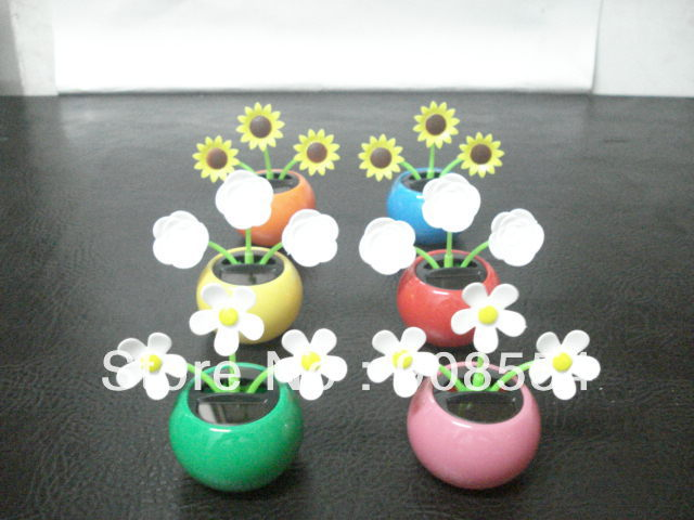 Free Shipping 10Pcs Per Lot All Flowers Dancing No Battery No Water Novelty New Style Solar Gift Solar Toy Car Decoration(China (Mainland))