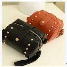 The new 2015 single shoulder slope across small women's handbag joker rivet bag two color optional