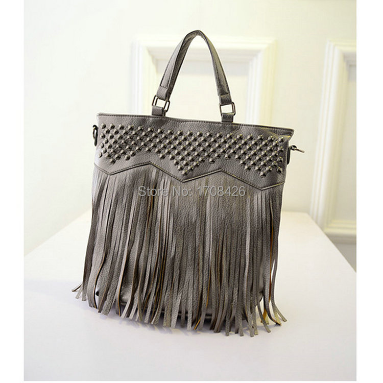 2014 Autumn new Korean rivet fringed shoulder bag Messenger female wild casual fashion handbags factory outlets(China (Mainland))