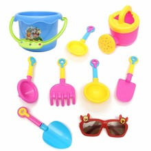 9pcs Kids Seaside Excavating Tools Beach Sand Play Water Toys Enclosed Spade Shovel Sunglasses Outdoor Fun Hourglass Paddle Set(China (Mainland))