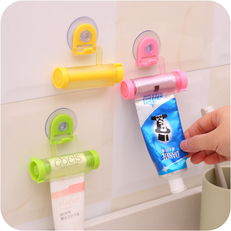 Bathroom practical rolling tube toothpaste squeezer useful easy dispenser bathroom toothpaste holder bathroom gadgets(China (Mainland))