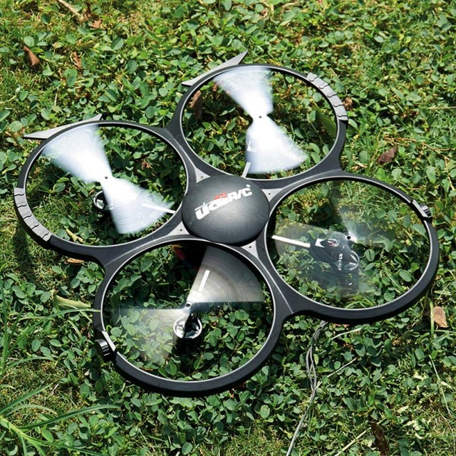drone Headless Gyro RC helicopter UFO can 3D Flip 2.4G 4ch 6 Axis Drone RC quadcopter 5.0M camera with remote control helicopter(China (Mainland))