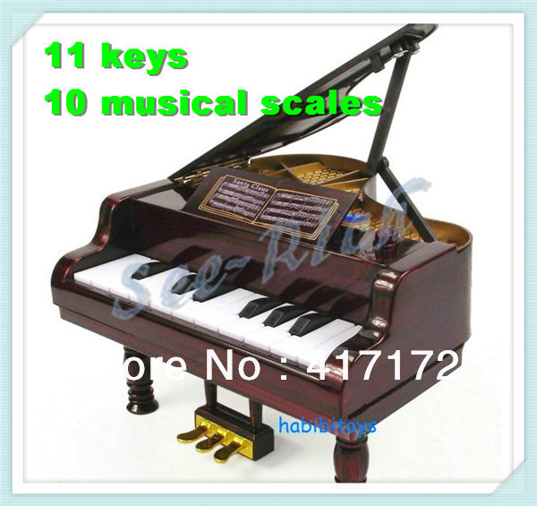 1pcs/box! Children's toy piano / Simulation of the piano with 11 keys / 10 musical scales / Electronic music toy Free shipping(China (Mainland))