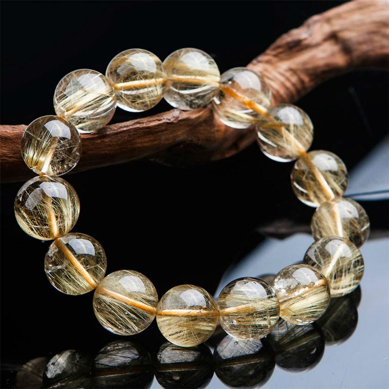 2016 New Women Mens Stretch Bracelet Big 15mm Brazil Natural Titanium Gold Hair Rutilated Quartz Crystal Round Bead Bracelet(China (Mainland))
