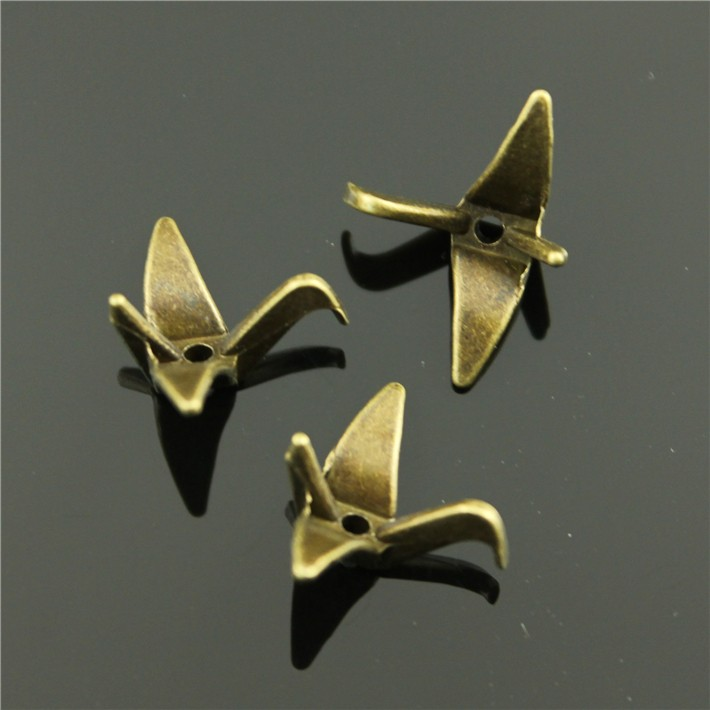 50pcs/lot 23*24*10mm 2 colors antique bronze, antique silver plated Paper cranes charms(China (Mainland))