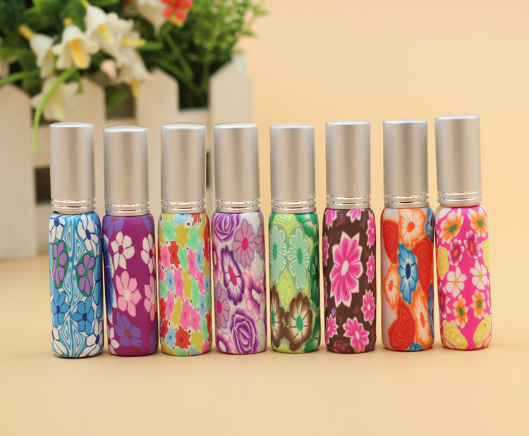 50pcs/Lot Hot Sales pump 10ml Clay Glass Perfume Bottle Travel Polymer Clay Fimo Empty Spray Scent Bottle Pump Case Random Color(China (Mainland))