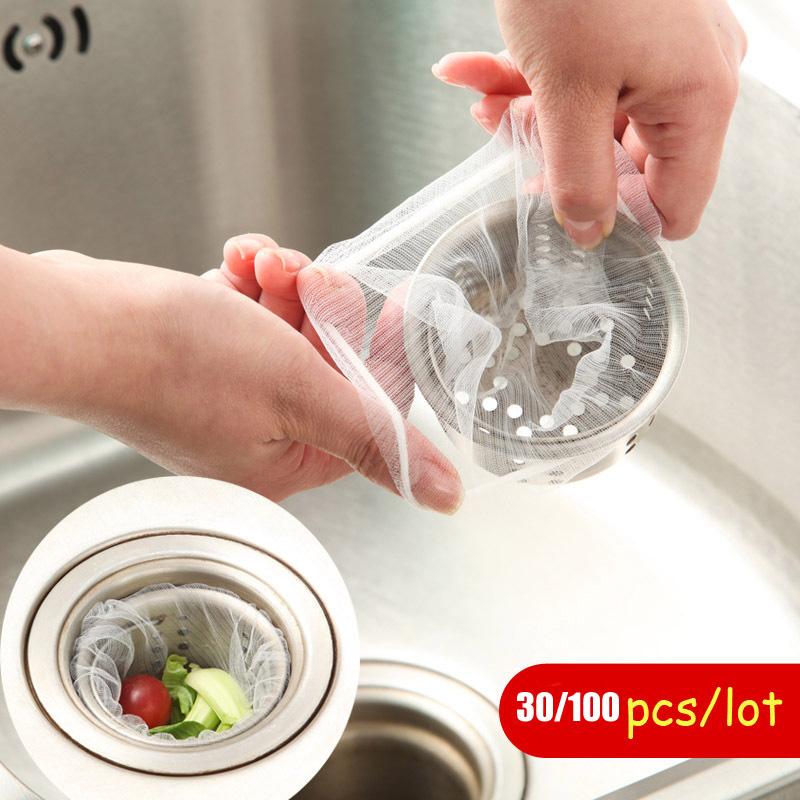 30pcs/lot garbage bag kitchen hair drain stop sink water bags net Vegetable bathroom trash strainer filter drainer work plastic(China (Mainland))