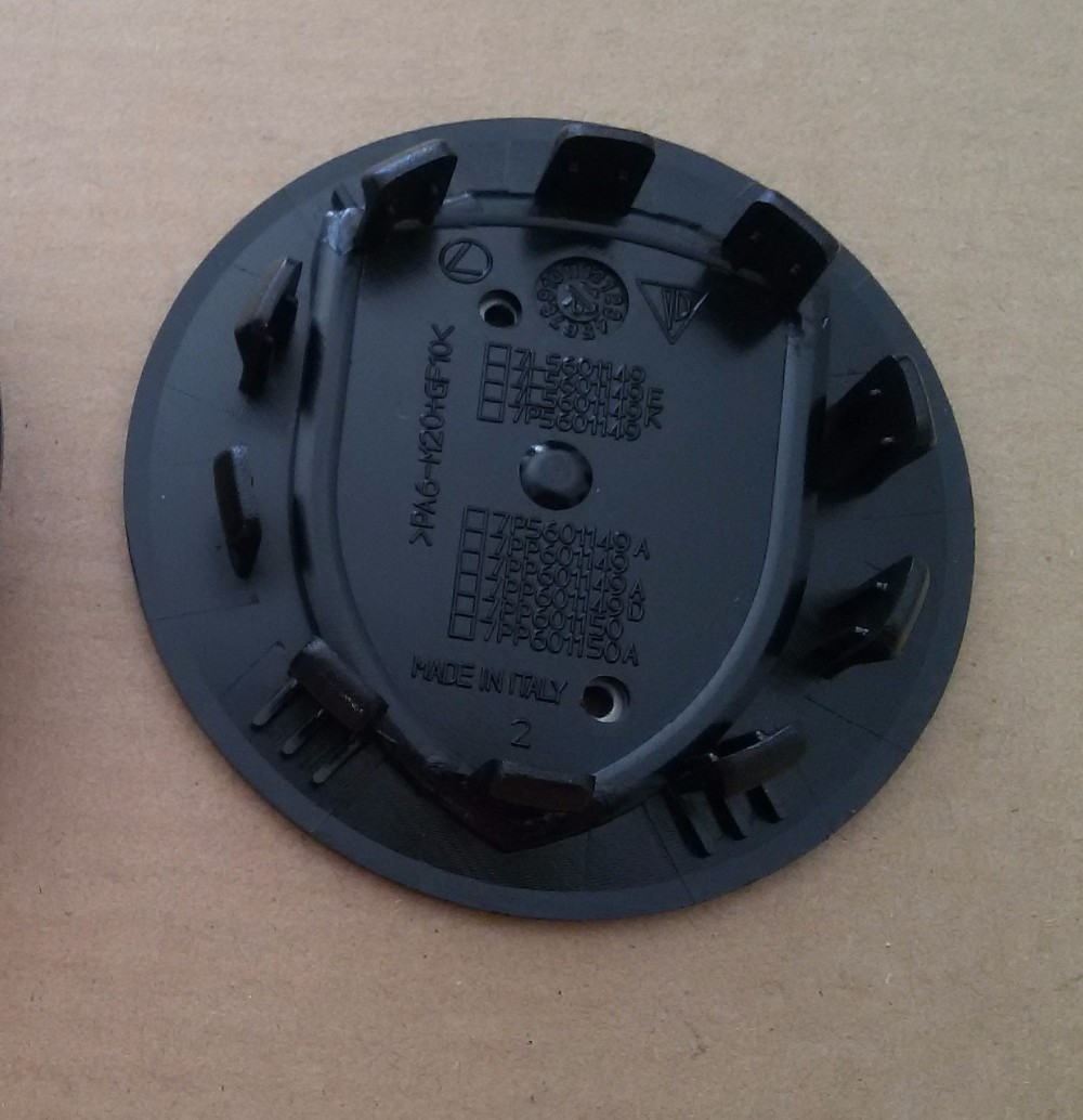 Factory Price 50pcs 75mm Wheel center hub caps for Pors black color ten teeth dhl shipping car styling(China (Mainland))