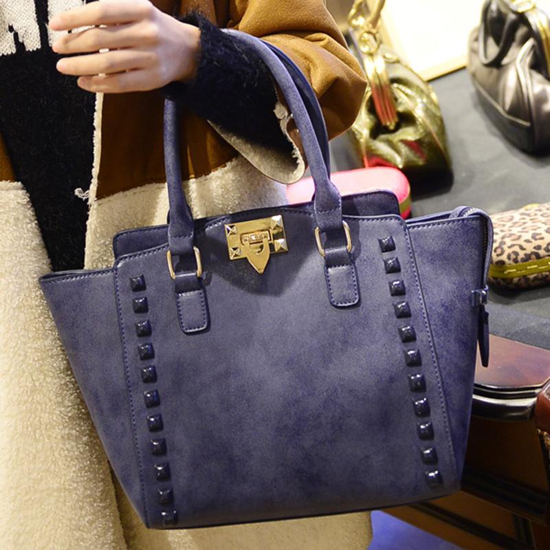 2014 autumn and winter fashion rivet bucket bag the trend of casual women's handbag one shoulder cross-body handbag