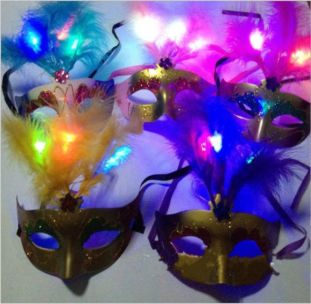 The new PVC Halloween, Mardi Gras masquerade party masks, woman luminous painted feather face masks(China (Mainland))