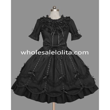 Black gothic lolita dress featuring exquisite lace and multiple ribbon ties