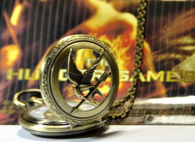 New small hunger game pocket watch necklace