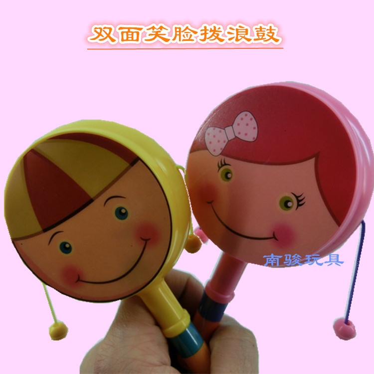 Cartoon smiling face rattle Double hand bell traditional baby rattle drum Children's early education toys baby toy(China (Mainland))