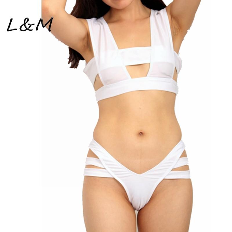 2015 New design sexy Bikini set, brazilian retro white black swimwear bandage hollow out swimsuit vintage bathing suit(China (Mainland))