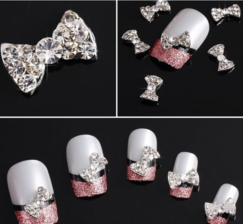 New 2015 Lot 10Pcs 3D Clear Alloy Rhinestone Bow Tie Nail Art Slices Diy Decorations(China (Mainland))