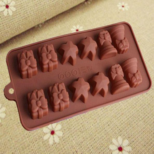 Familie kuchen dekorieren 12 Löcher christmas bells sterne geschenke schokoladenform französisch Gebäck design silikonformen versandkostenfrei(China (Mainland))