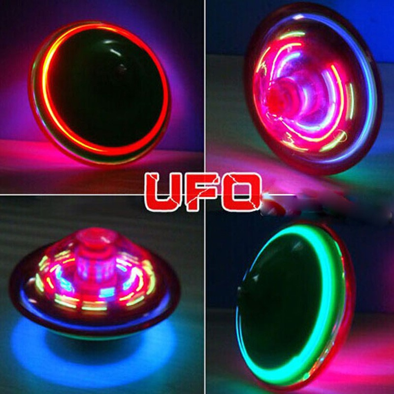 Free Shipping Laser Color Flash LED Light Toy Music Gyro Peg-Top Spinner Spinning Kids Toy(China (Mainland))
