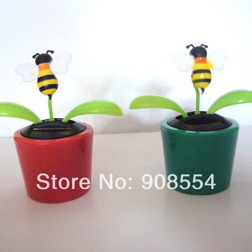 Wholesale 15 Pcs Per Lot Magic Cute Flowers Flip Flap Gently Car Decoration Novelty Happy Dancing Solar Flowers(China (Mainland))