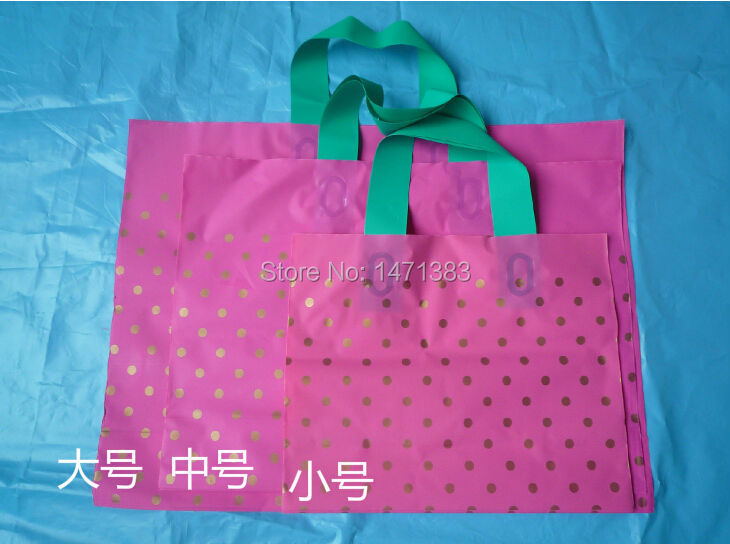Size 35*25+8cm shopping plastic bag/t-shirt packaging bag with handle(China (Mainland))