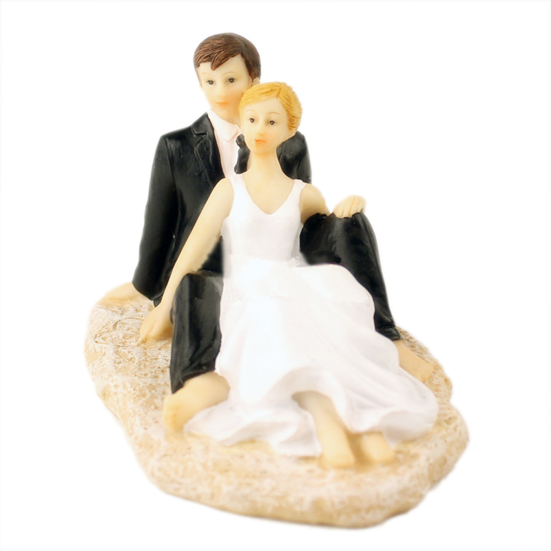 sitting romantic beach bride and groom wedding cake topper
