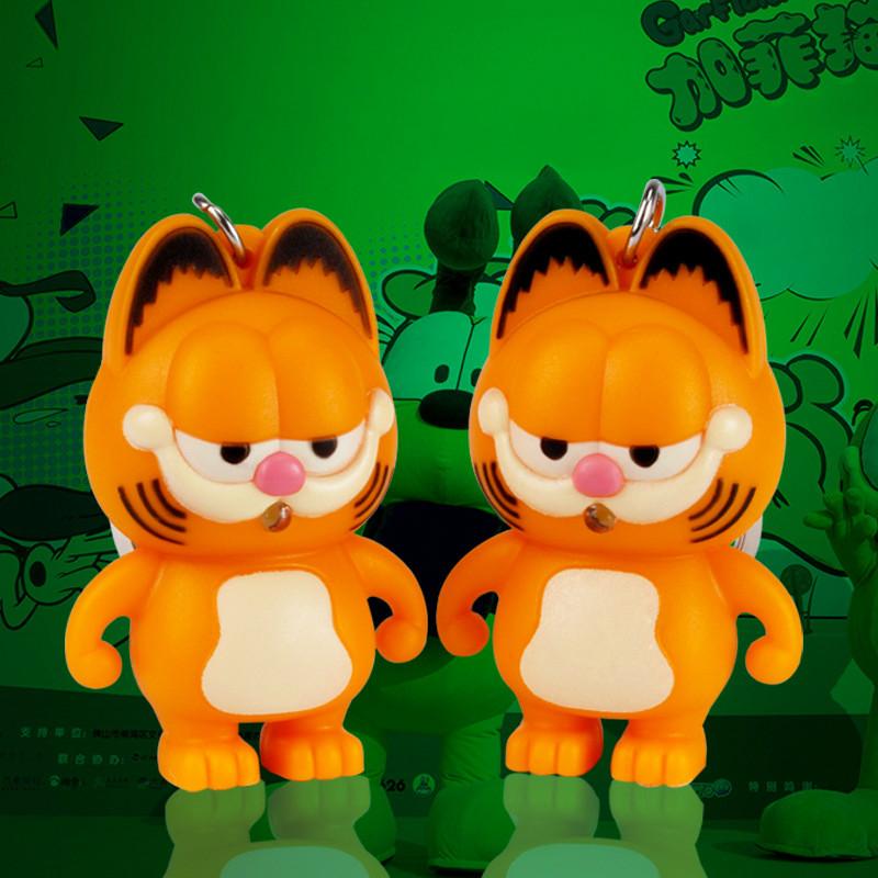 Garfield LED sound and light Keychain creative cartoon car mobile phone pendant flashlight doll key chains(China (Mainland))