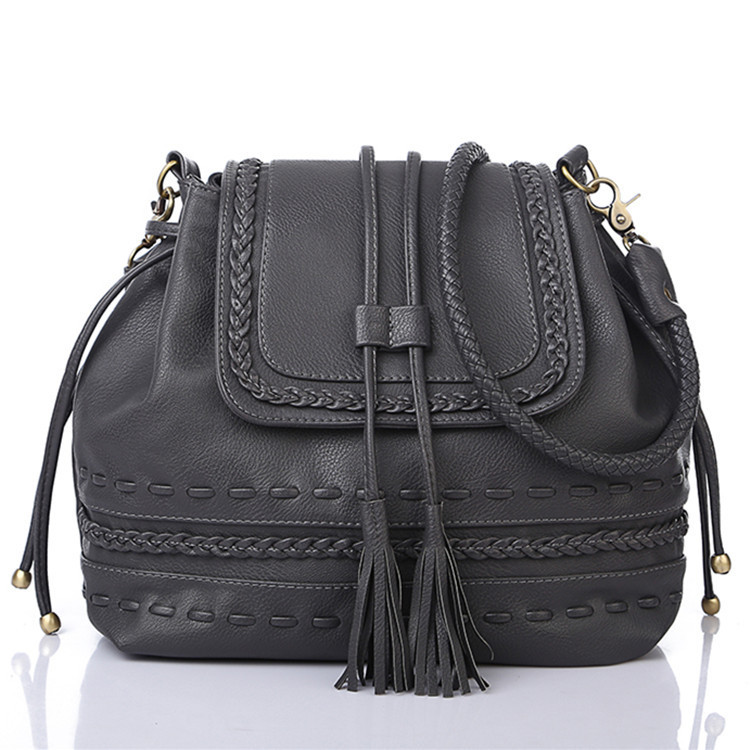 2015 causal Large capacity bucket bag the influx of new handbags fringed retro shoulder women s