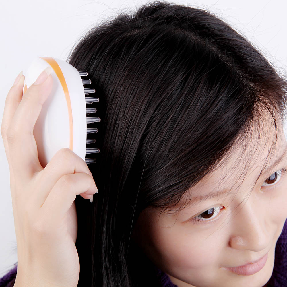 Anti-Static Mini Electric Scalp Massage Comb Promote Blood Circulation Brush Head Massager(China (Mainland))