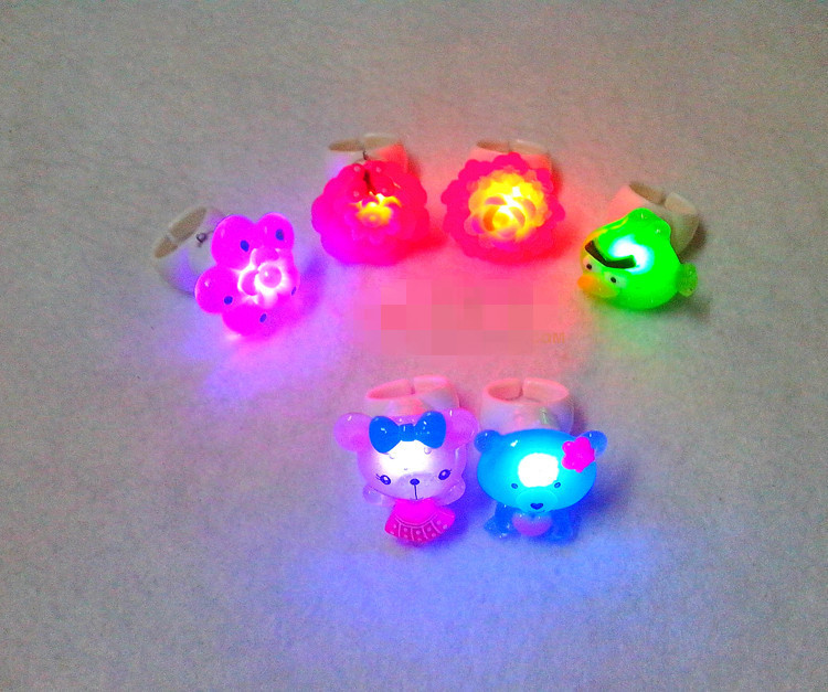 50pcs/lot Creative LED Glowing Finger Rings,Bird Bear Flower Party Favors Flaring Flash Ring Light for Kids Favors toys(China (Mainland))