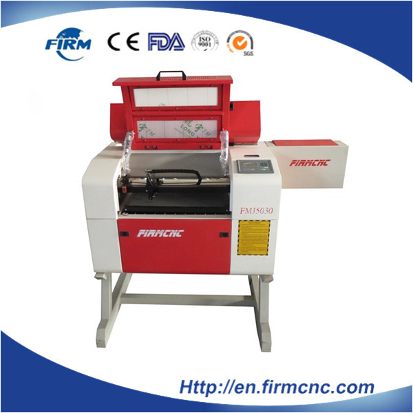 High quality wood cardboard MDF stone laser engraving machine for sale(China (Mainland))