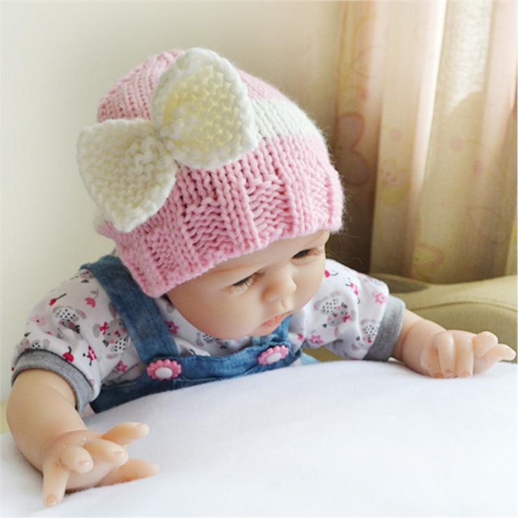 Вязание шапочек на новорожденных. для девочек6