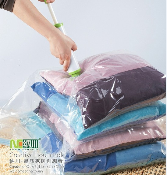 Free shipping Compression bags vacuum cleaner pump dual bag home supplies quilt clothes packing storage(China (Mainland))