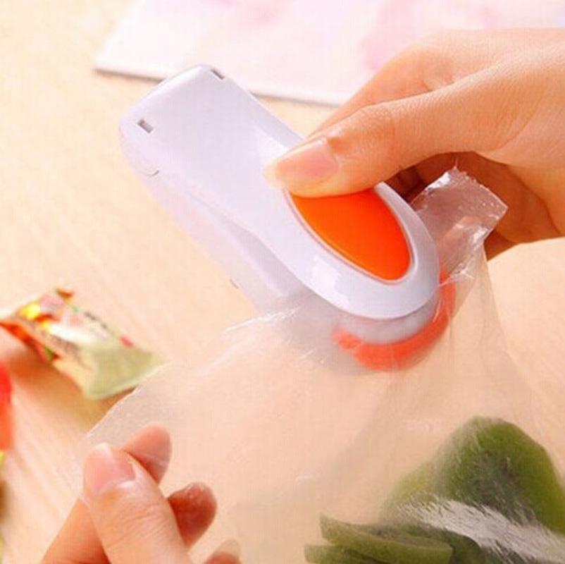 Easy Handy Heating Sealer Plastic Bag Mini Vacuum Packer Food Electric Sealing Machine Kitchen Accessories Households(China (Mainland))