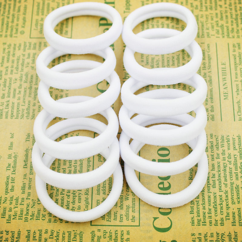 2015 New 50pcs/bag 40mm Pure White Hair Holders Rubber Bands Elastics Girl Women Tie Gum Fashion Free Shipping(China (Mainland))