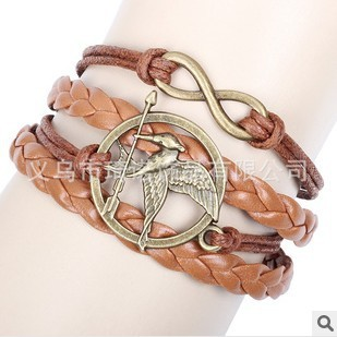 SL016 New Christmas Gifts Handmade Braided Leather Cord Bracelet The Hunger Games bird Charm Bangle