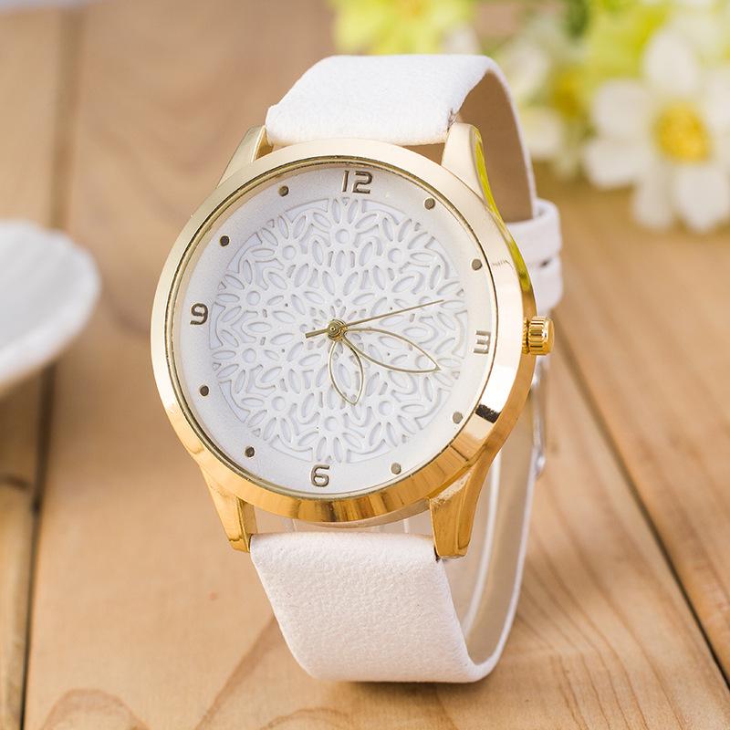 MINHIN Hot Sale Ladies Quartz Watch 9 Colors Hollow Pattern Design Wrist Bracelet Personality Pointer Round Wristwatches(China (Mainland))