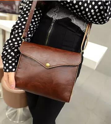 Free shipping new 2014 vintage young artists buckle small shoulder bag diagonal handbags packet(China (Mainland))