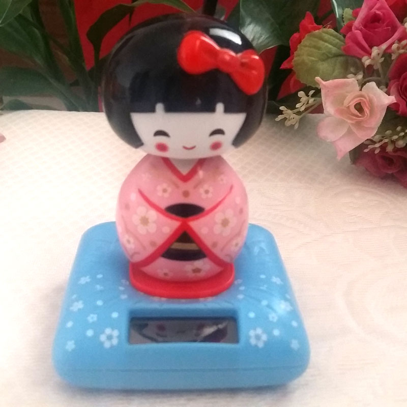 Retail Package New Style Shaking Head Under Full Light No Battery Creative Home&car Decoration Gift Pink Solar Energy Dancer Toy(China (Mainland))