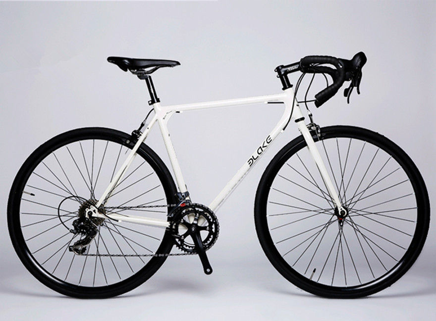 High-carbon steel breaking wind road bike racing gear 8/14 speed male female students bicycle cycling Leisure street sports(China (Mainland))