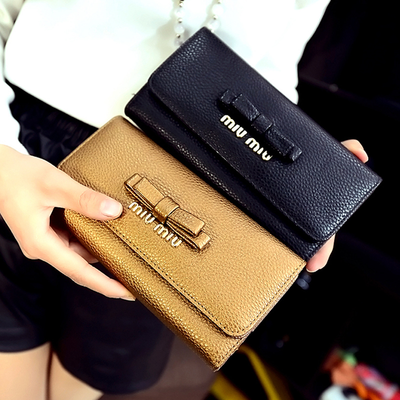 Bowknot monederos 2015 new luxurious wallets ladies leather long women wallet(China (Mainland))