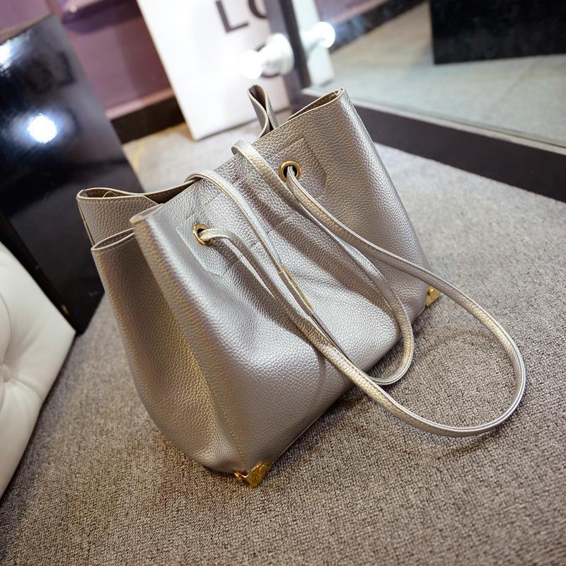 2015 new handbag with silver stars tumble Pu beach picture package baodan shoulder bag(China (Mainland))