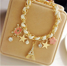 The new jewelry fashionable star flower tower cards leather rope Paris Eiffel Tower crown Bracelet(China (Mainland))