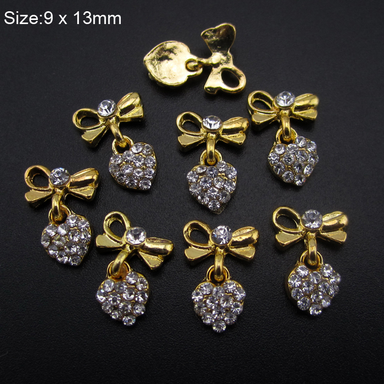 10pcs Glitter Strass heart design nail gold alloy 3d nail art decoration bows chain for nail AM394(China (Mainland))