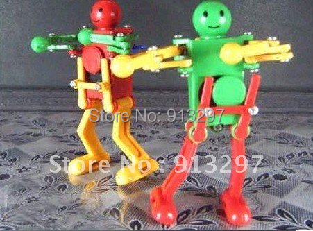 wholesale kids wind up toys educational toys dancing robots rock roll robots unique toys(China (Mainland))