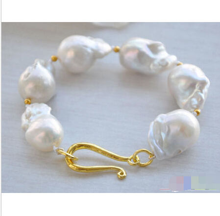 A Beautiful 8 3row 10mm natural white round freshwater pearl bracelet<br><br>Aliexpress