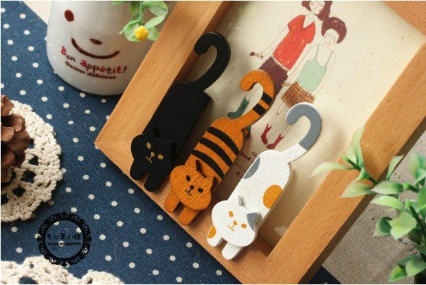Smiling Wooden Cats Clips